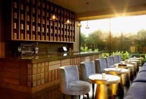 A restaurant or other place to eat at Roseate House New Delhi