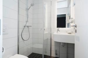 A bathroom at Thon Hotel Tønsberg Brygge