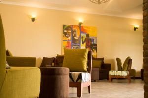 The lobby or reception area at Airport Planet Lodge