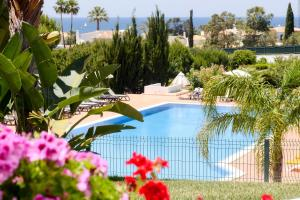 A view of the pool at Moradias Villas Rufino or nearby