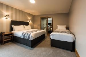 A bed or beds in a room at Springfield Hotel