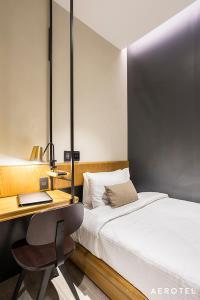 Cama ou camas em um quarto em Aerotel Galeão Terminal 2