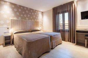 Cama o camas de una habitación en Hotel Santa Marta