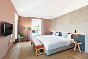 Uma cama ou camas num quarto em OnJ S. Lazaro Lisboa