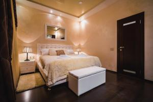 A bed or beds in a room at Boutique Hotel Renaissance