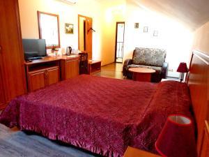 Кровать или кровати в номере Hotel Guberniya