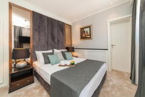 A bed or beds in a room at Hotel Casa del Mare - Amfora