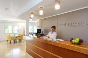 Лобби или стойка регистрации в Hotel Menorca Patricia
