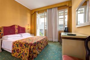 Cama ou camas em um quarto em Hotel Biasutti