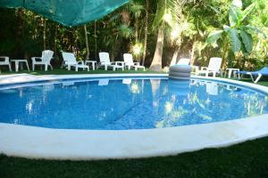 The swimming pool at or near Villa espectáculo B&B