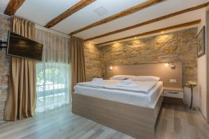 Ein Bett oder Betten in einem Zimmer der Unterkunft Minella Residence