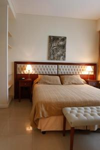 Una cama o camas en una habitación de Alta Piazza –Casa di Appartamenti–