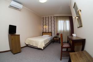 Кровать или кровати в номере Olympos Hotel
