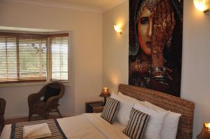 A bed or beds in a room at Nirvana at Montville