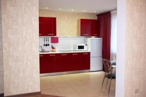 A kitchen or kitchenette at Business Apartments on Moskovsky Prospekt