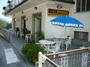 A restaurant or other place to eat at Albergo Ristorante Regina