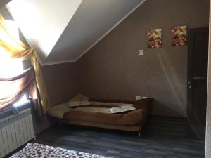 A bed or beds in a room at Bungalo Family House