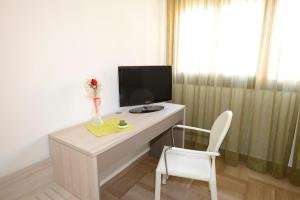 A television and/or entertainment center at BB Venice Cinzias'