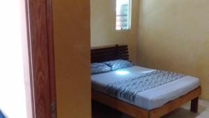 Cama ou camas em um quarto em Aguasclaras Residencial
