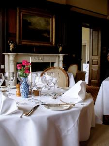 A restaurant or other place to eat at Tillmouth Park Country House Hotel