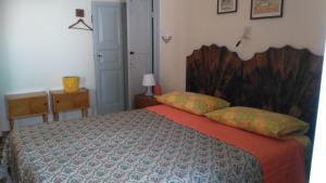 Letto o letti in una camera di B&B La Casa Dei Nonni