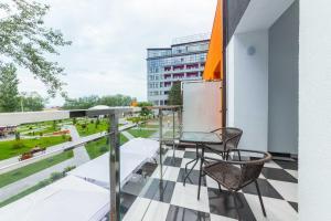 Балкон или терраса в BETON BRUT All Inclusive & Spa Hotel in Miracleon
