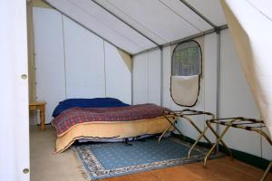 A bed or beds in a room at Bedroll and Breakfast ™