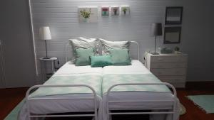 A bed or beds in a room at Casa do Vale das Furnas