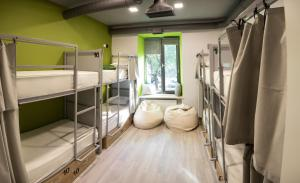 A bunk bed or bunk beds in a room at Youth Hostel