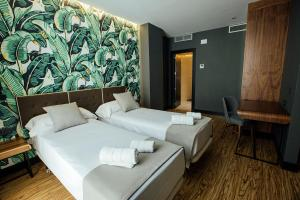 A bed or beds in a room at Malaga Premium Hotel
