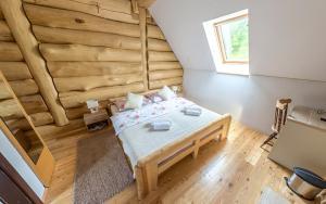 Postel nebo postele na pokoji v ubytování BeaR's LOG