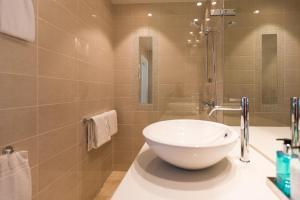 A bathroom at 2 Døtre Apartments