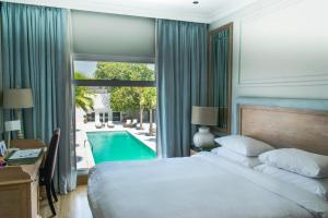 A bed or beds in a room at The Palace Boutique Hotel