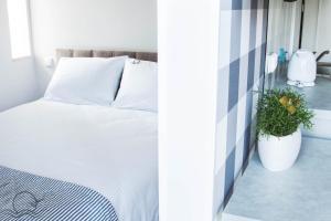 Łóżko lub łóżka w pokoju w obiekcie Słoneczna - Komfortowe Pokoje i Apartamenty