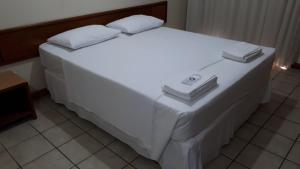 A bed or beds in a room at Hotel Sol da Praia