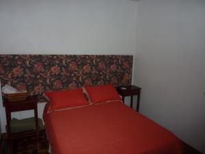 Cama ou camas em um quarto em Pousada Casa Amarela