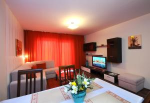 A television and/or entertainment center at Alpe-Adria Apartments