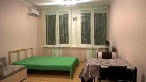Кровать или кровати в номере Апартаменты на Лысой Горе