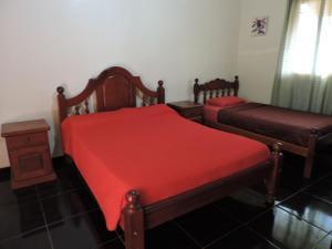 Una cama o camas en una habitación de Hostel Park Iguazu