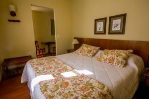 Cama ou camas em um quarto em Pousada Albergo Del Leone