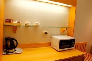 A kitchen or kitchenette at Sandown Regency Hotel & Apartments