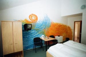 TV/Unterhaltungsangebot in der Unterkunft Motel Dacice