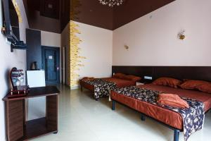 A bed or beds in a room at VIP Hotel