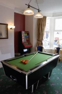 A pool table at Glenthorn Private Hotel