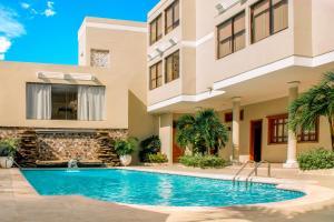The swimming pool at or near Hotel Ayenda Majestic 1324