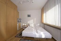 A bed or beds in a room at Appart International Boarding House