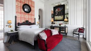 A bed or beds in a room at JW Marriott Phu Quoc Emerald Bay Resort & Spa