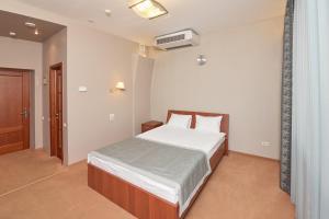 Кровать или кровати в номере Гостиница Аврора