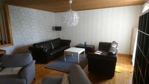 A seating area at Torp Källtorp B&B