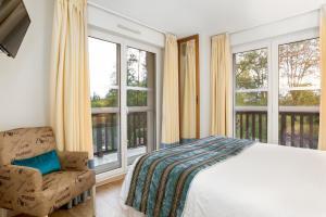 Un ou plusieurs lits dans un hébergement de l'établissement Karma Manoir des Deux Amants
